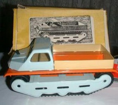 Гусеничная Советская игрушка. Похожа на снегоход.