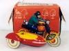 Маленький игрушечный мотоцикл с коляской. Игрушки детей Советского Союза.