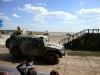 Военный автомобиль Тигр проходит мимо трибун. Фото.