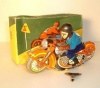 Советская детская игрушка, заводной мотоцикл.